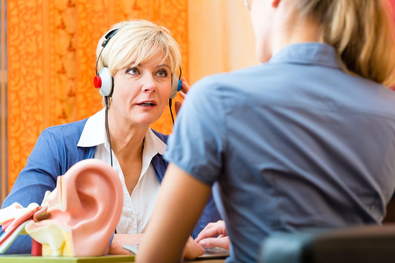 Female Australian pensioner having a hearing test